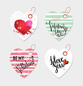 Set of four hand drawn gift tags for wedding or Valentine day. Handwritten lettering. Template for sticker, label, banner, invitation, postcard, card, wrapping and packaging. Vector illustration.