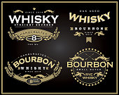 Vector illustration of a set of four retro Bourbon Whisky labels.