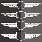 Set of four winged grunge emblems