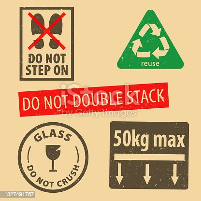 istock Set of fragile sticker handle with care and case icon packaging symbols sign, do not step on, glass rubber stamp on cardboard background, vector illustration. Use on package. 1327491757