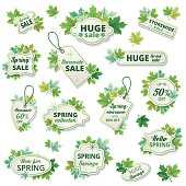 Bright green sale tags with assorted maple leaf  decorations. The tags have a drop shadow and a thin border inside. There is text inside. There are various shaped labels decorated with leaves.