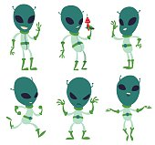 Set of funny green aliens, flat style