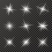 Set of glowing lights, stars and sparkles isolated on black