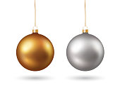 Set of gold and silver colored realistic shiny christmas baubles isolated on white background