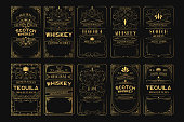 istock Set of golden alcohol labels. Vintage gold scotch, whiskey, tequila, rum frames for bottle with lettering. 1211998149