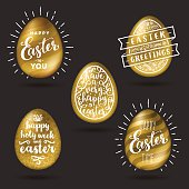 Set of golden eggs with Easter greeting type design