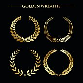 Set of  luxury golden wreaths on a black background. Vector design elements