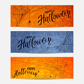 Lettering Happy Halloween on the banners with spiders and cobwebs, orange and blue grunge background, illustration.