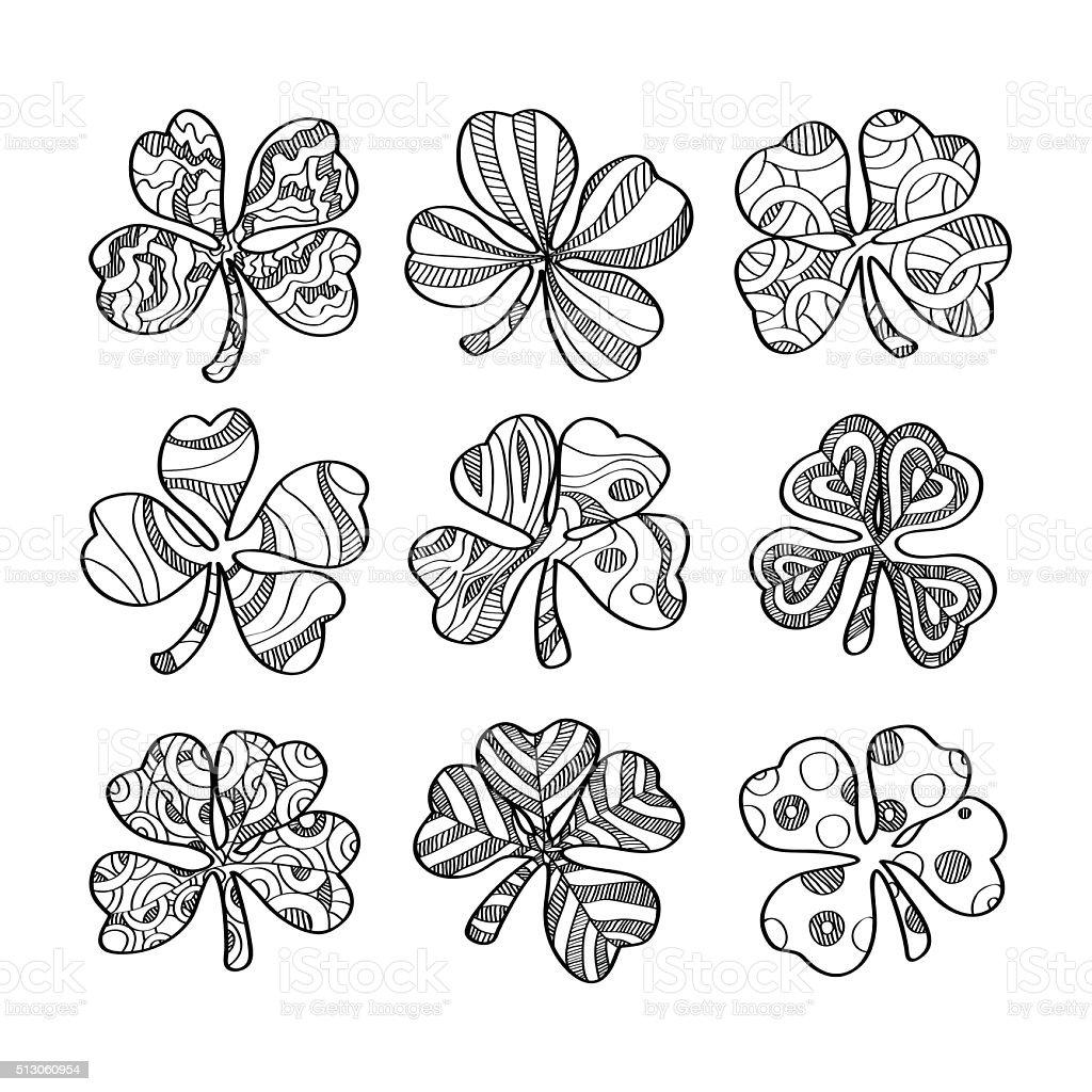 set of hand drawn monochrome shamrock isolated on white background