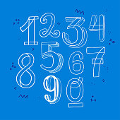 Full set of hand drawn lettering figures from zero to nine. Line art style numerical symbols 1234567890. Contour drawing numbers with doodle elements on blue background. Vector illustration isolated