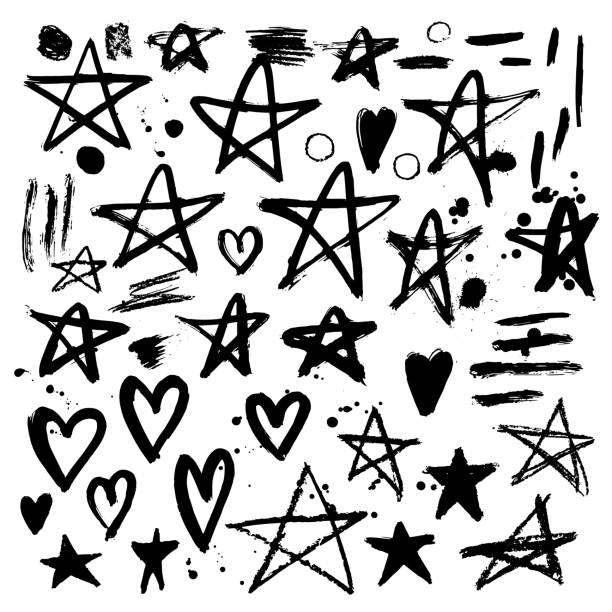 Set of hand drawn stars and hearts. Grunge elements. Brush strok vector art illustration