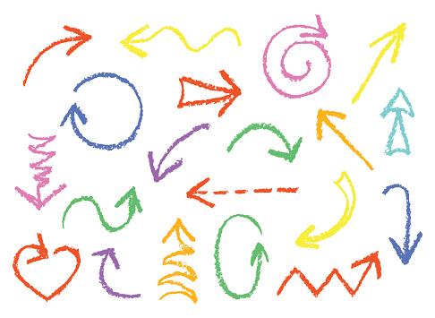 Set of hand drawn wax crayon fun colorful arrows.