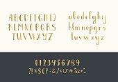 Set of handwritten gold latin letters. Vector script font. Golden alphabet isolated on background.