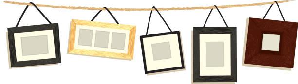 set bilderrahmen hängen am seil weißem hintergrund - palettenbilderrahmen stock-grafiken, -clipart, -cartoons und -symbole