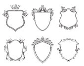 Vector set of different heraldic shields with various decorative elements on a white background. Coat of arms, heraldry, emblem, symbol. Made in monochrome style. Line art. Vector illustration.