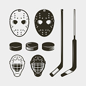 set of hockey equipment and gear. helmet, mask and puck. sport design elements for logotypes and emblems. vector illustration
