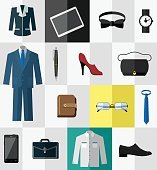 Several professional items and articles of clothing shown.  The top row, from left to right, shows a dark women's business jacket, a tablet, a black bow tie and a black watch.  A full blue men's business suit takes up the far left space of rows two and three.  The second row shows a pen, a red high-heeled shoe and a black purse.  The third row has a brown day planner, a pair of eyeglasses and a blue neck tie.  The bottom row displays, from left to right, a black smartphone, a dark briefcase, a white shirt and a black dress shoe.