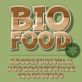 Vector set of alphabet letters, numbers and punctuation symbols. Wooden banner for ecology activity with text Bio food. File contains graphic styles