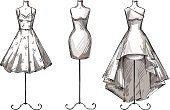 Set of mannequins. Dummies with dresses. Fashion illustration. Vector sketch. EPS 10.