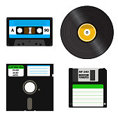 Set of media of different generations - vinyl record, cassette tape, a 3.5-inch floppy disk on a 5.25-inch diskette. Isolated on white background.