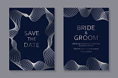 Set of two cards with silver waves of lines on a navy blue background.