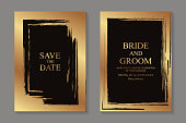Set of two cards with golden paint brush strokes frames on a black background.