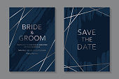 Set of two cards with silver lines and paint brush strokes on a navy blue background.