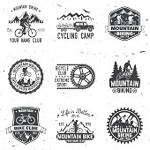 Set of Mountain bikings clubs. Vector illustration. Concept for shirt or icon, print, stamp or biking tourism. Vintage typography design with forest, mountain bikes silhouette.