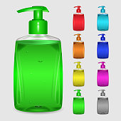 Set of multicolored bottles with liquid soap