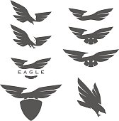 Set of negative space emblems with eagles