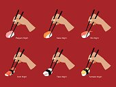 Set of Nigiri sushi grabbed  by chopsticks