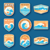 Set of nine summer holidays emblems. Labels with sun, waves, and sand in bright blue and orange colors. Beach emblems, badges and logo patches. Summer holidays, surfing. Vacation labels in vintage style