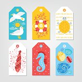 Set of ocean Gift Tags with seagull, sun, cloud, turtle, lifebuoy, coral, shell, sea horse in White, Red, Yellow and Blue. Perfect for holiday greetings