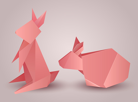 Set of origami paper rabbits separately from the background.