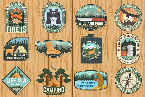 Set of outdoor adventure quotes symbol. Vector. Concept for shirt or print, stamp or tee. Vintage design with hiking boots, binoculars, mountains, fishing bear, deer, tent and forest silhouette