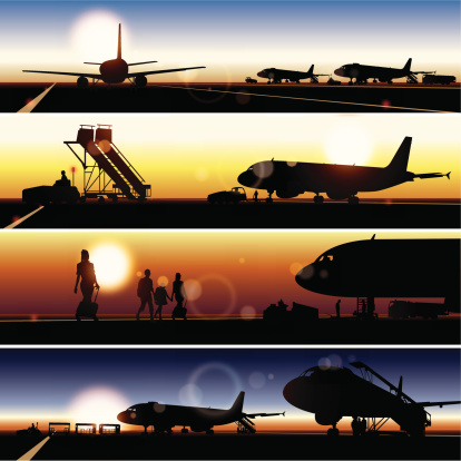Set of panoramic views of airplane silhouettes at sunset