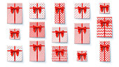 Set of present boxes, flat lay. Top view on wrapped in colored paper gift boxes with satin red bows. Vector concept of packages for Christmas, New Year, Happy birthdays, Weddings and Valentine Day