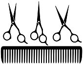 set of black professional scissors on white background and comb