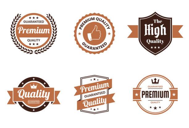 """zestaw brązowych plakietek i etykiet """"quality"""" - elementy projektowe - przypinka stock illustrations"""