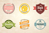 "Set of 6 ""Quality"" Vintage multicolored badges and labels (Red, orange, yellow, green, blue, pink), isolated on a brown retro background with an effect of old textured paper (Premium - Guaranteed Quality, Premium Quality Guaranteed, The High Quality, Quality - Guaranteed, Premium Quality - Guaranteed). Elements for your design, with space for your text. Vector Illustration (EPS10, well layered and grouped). Easy to edit, manipulate, resize or colorize."