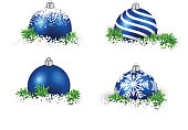 Colorful set of blue realistic christmas balls on snow with fir branches. Vector illustration.
