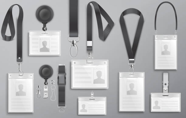 Set of realistic employee identification card on black lanyards with strap clips, cord and clasps vector illustration Set of realistic employee identification card on black lanyards with strap clips, cord and clasps vector illustration id card stock illustrations