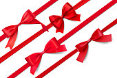 Set of realistic satin red bows. Vector illustration isolated on white background.