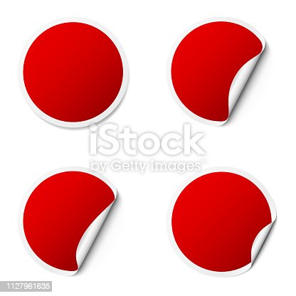 Set of red round adhesive stickers with a folded edges, isolated on white background.