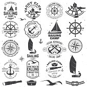 Set of sailing camp and yacht club badge. Vector. Concept for shirt, print, stamp or tee. Vintage typography design with black sea anchors, hand wheel, compass and sextant silhouette.