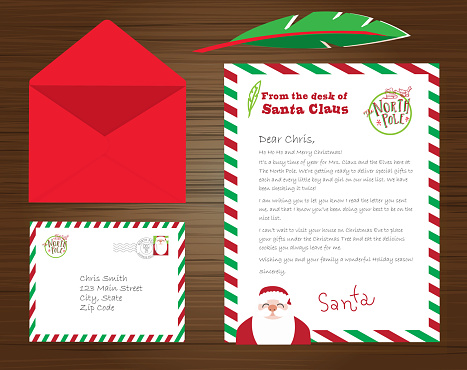 Set of Santa Claus letters, envelope and quill pen on wooden background