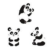 Set of silhouettes of sitting panda cubs. Hand drawing.