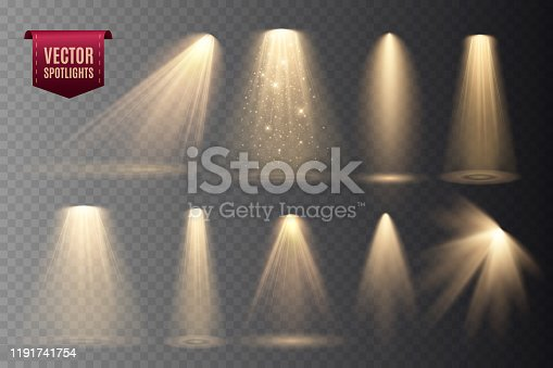 Set of Spotlights isolated on transparent background. Vector glowing light effect with gold rays and beams