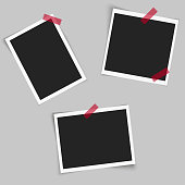 Set of square photo frames with red sticky tape on grey background. Vector