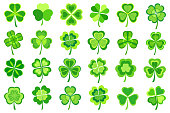 Set of stylized trendy green Patricks leaf clover isolated on white background. Beautiful elements of graphic design for St. Patrick's day. Stylish creative modern icons shamrocks. Vector illustration